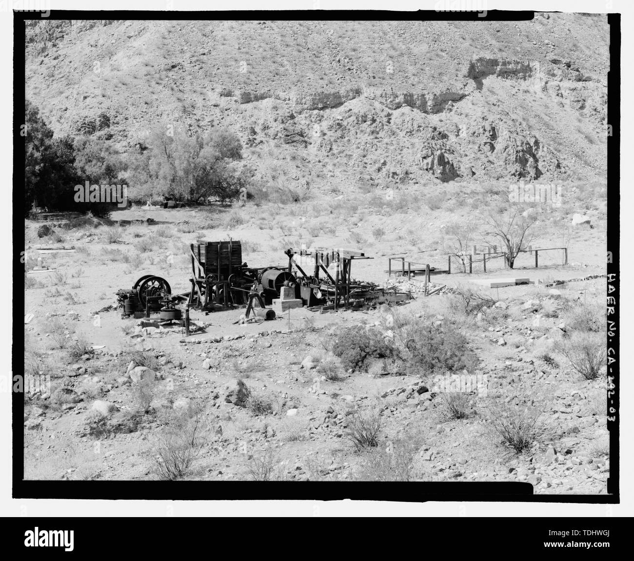 OVERVIEW OF GOLD HILL MILL, ROAD, AND WARM SPRINGS CAMP BUILDINGS, LOOKING SOUTHWEST. - Gold Hill Mill, Warm Spring Canyon Road, Death Valley Junction, Inyo County, CA - Stock Image