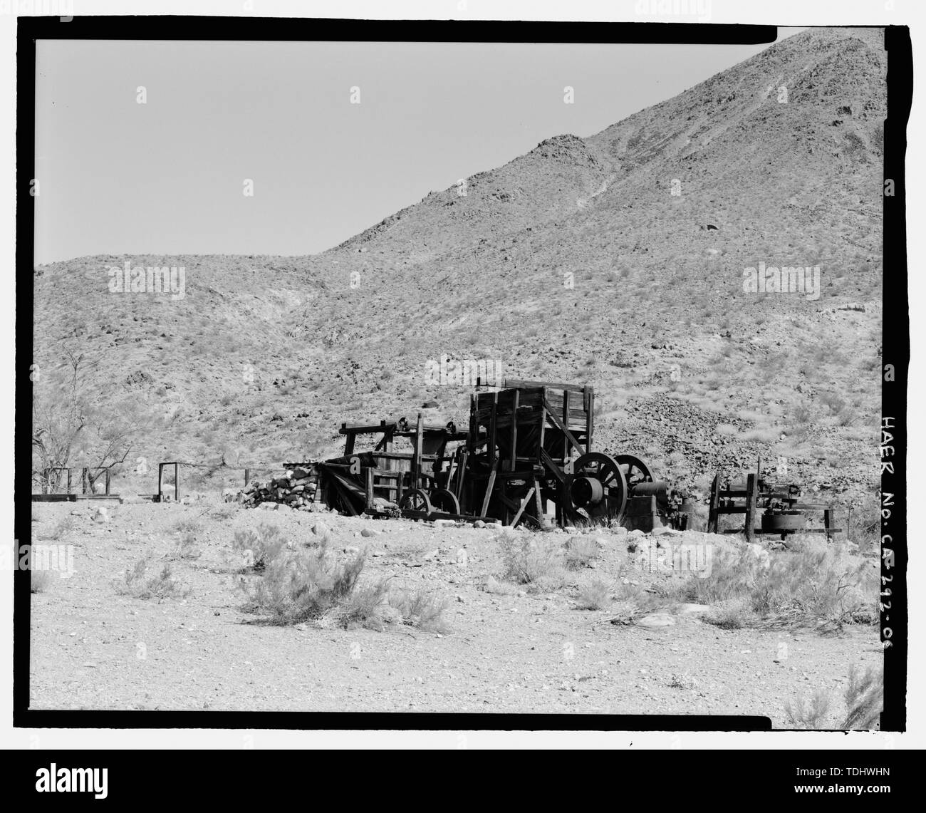 OVERVIEW OF GOLD HILL MILL, LOOKING NORTH. THE ARRASTRA IS ON THE RIGHT, TO THE LEFT OF THE ENGINE. - Gold Hill Mill, Warm Spring Canyon Road, Death Valley Junction, Inyo County, CA - Stock Image