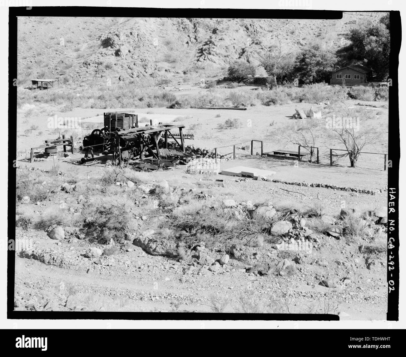 OVERVIEW OF GOLD HILL MILL, ROAD, AND WARM SPRINGS CAMP BUILDINGS, LOOKING SOUTH SOUTHEAST. THE FUNCTION OF THE FLAT AREA AT CENTER RIGHT IS UNKNOWN. - Gold Hill Mill, Warm Spring Canyon Road, Death Valley Junction, Inyo County, CA - Stock Image
