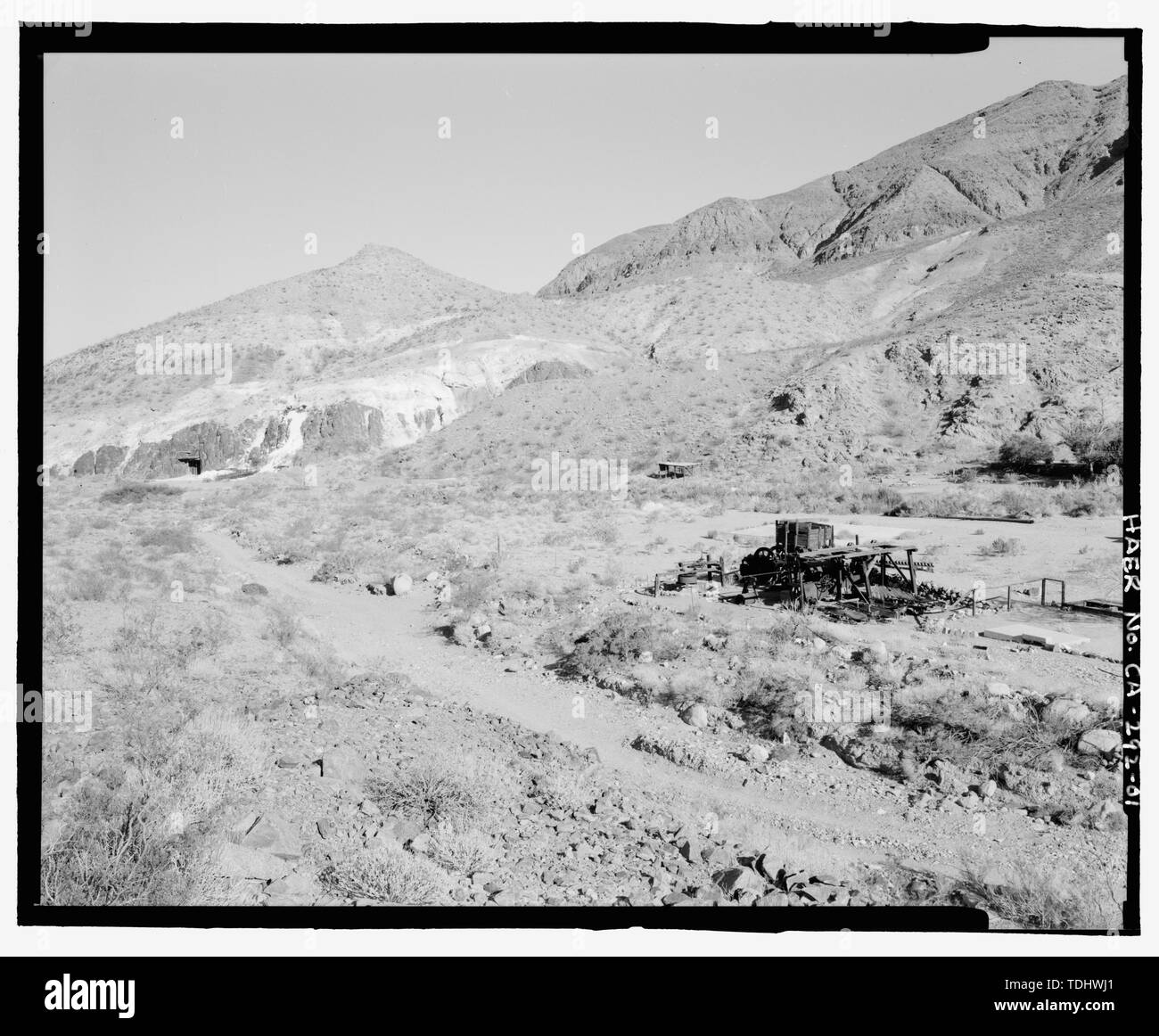 OVERVIEW OF GOLD HILL MILL, ROAD, AND WHITE PINE TALC MINE LOOKING EAST. THE OPENING TO THE TALC MINE IS IN THE DARK AREA AT CENTER LEFT EDGE. WARM SPRINGS CAMP IS OUT OF FRAME TO THE RIGHT. - Gold Hill Mill, Warm Spring Canyon Road, Death Valley Junction, Inyo County, CA - Stock Image