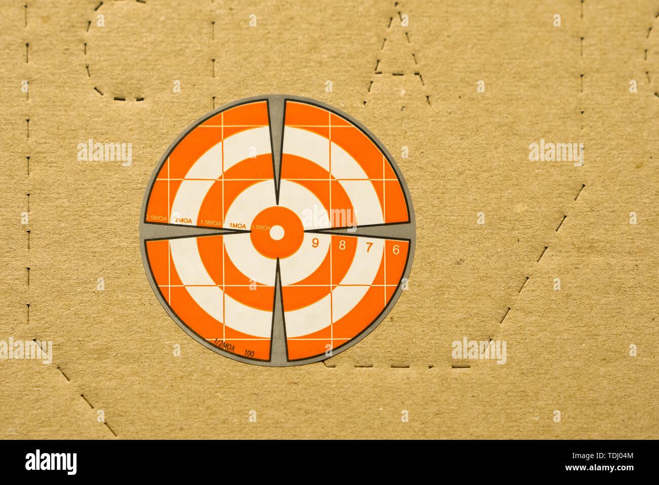 Paper orange target for shooting on IDPA target background - Stock Image