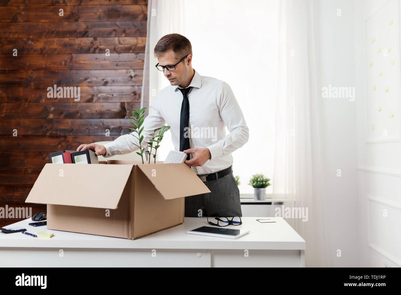 Successful businessman moving into a new office Stock Photo