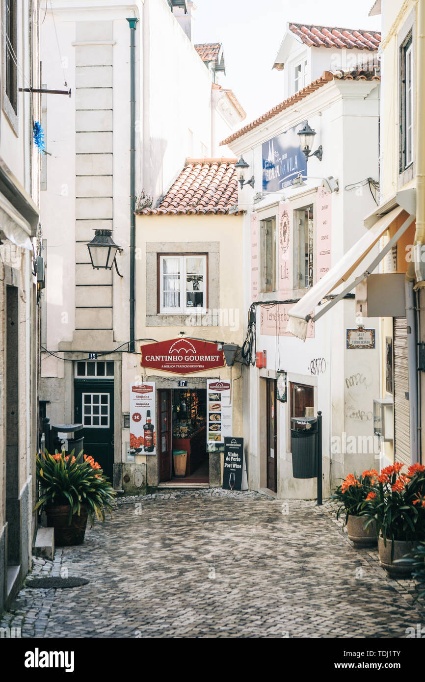 Portugal, Sintra, June 26, 2018: Beautiful view of the old street with a gourmet shop. - Stock Image