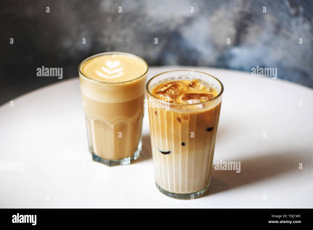 Latte And Ice Latte Coffee Glasses On White Table In Cafe Stock Photo Alamy