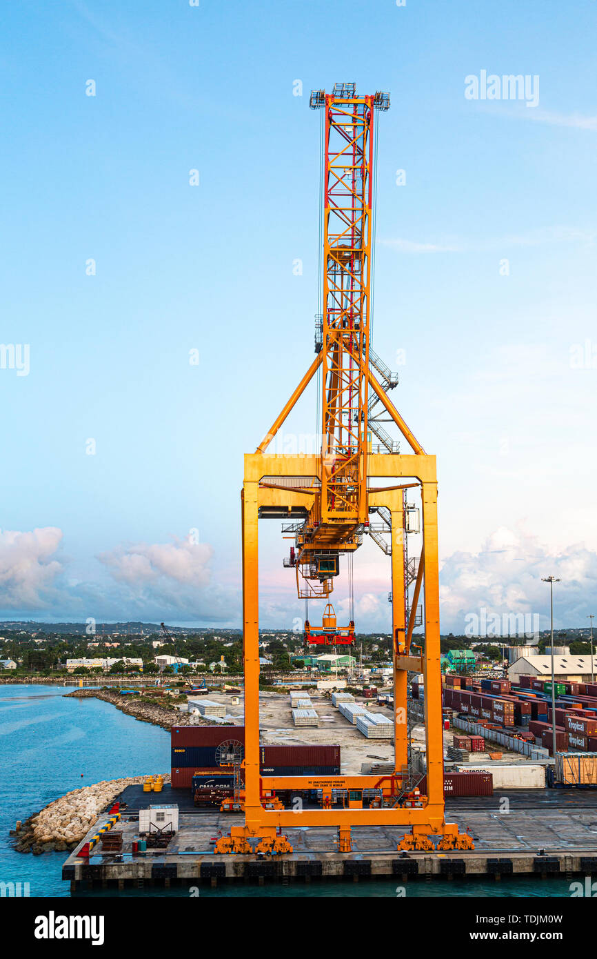 BRIDGETOWN, BARBADOS - November 22, 2016: Freighters now carry most of the world's cargo and the largest container ships can carry over 21,000 units o - Stock Image