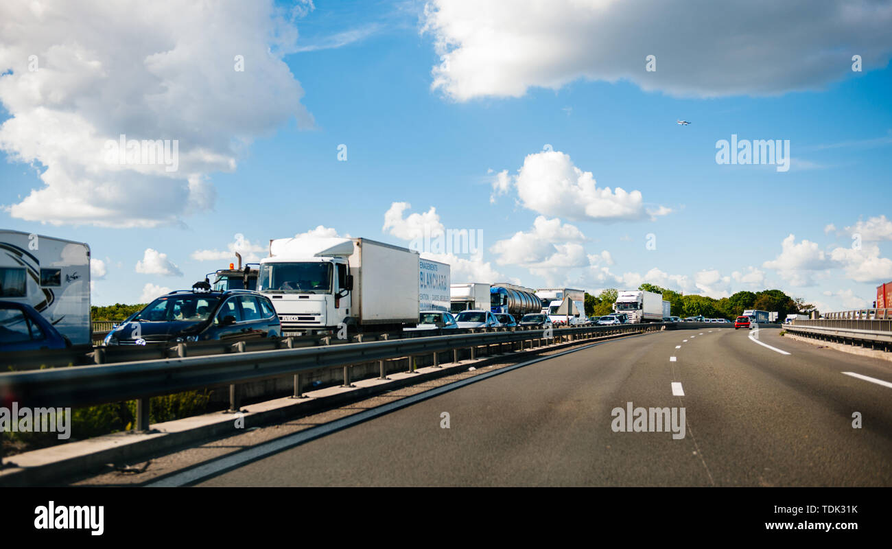 Paris, France - May 14, 2014: Driver POV point of view personal perspective at the traffic jam on the parallel lanes of French highway at the entrance in paris Stock Photo