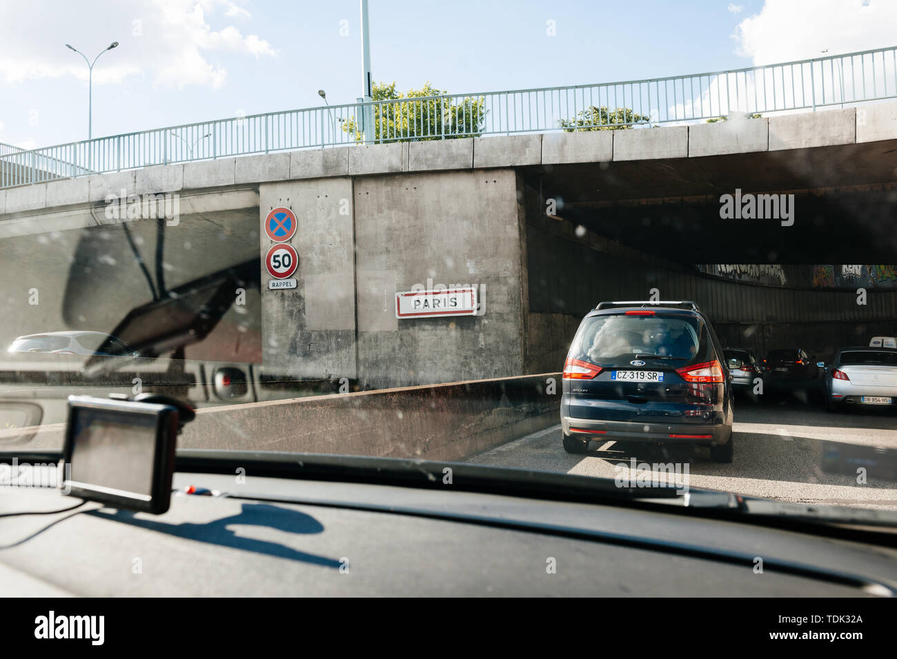 Paris, France - May 14, 2014: Driver POV point of view personal perspective at the traffic jam front driving cars entering Paris peripherique ring road highway - Stock Image