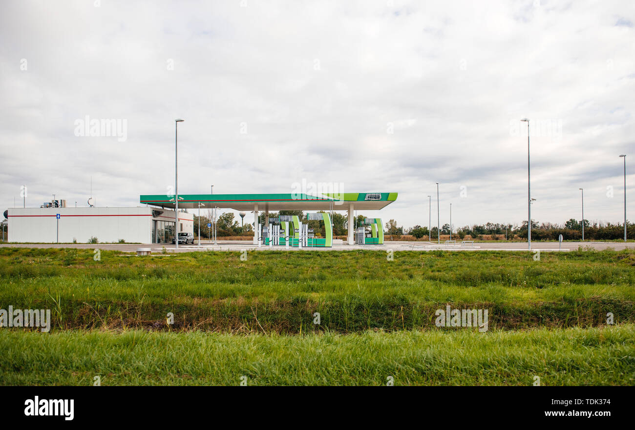 New modern empty gas station with closed pumps and hidden logotypes - expansion of modern oil petrol company - Stock Image