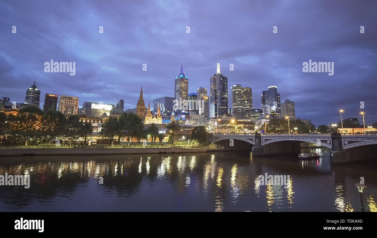 Night Time Wide Angle View Of A Boat On The Yarra River With