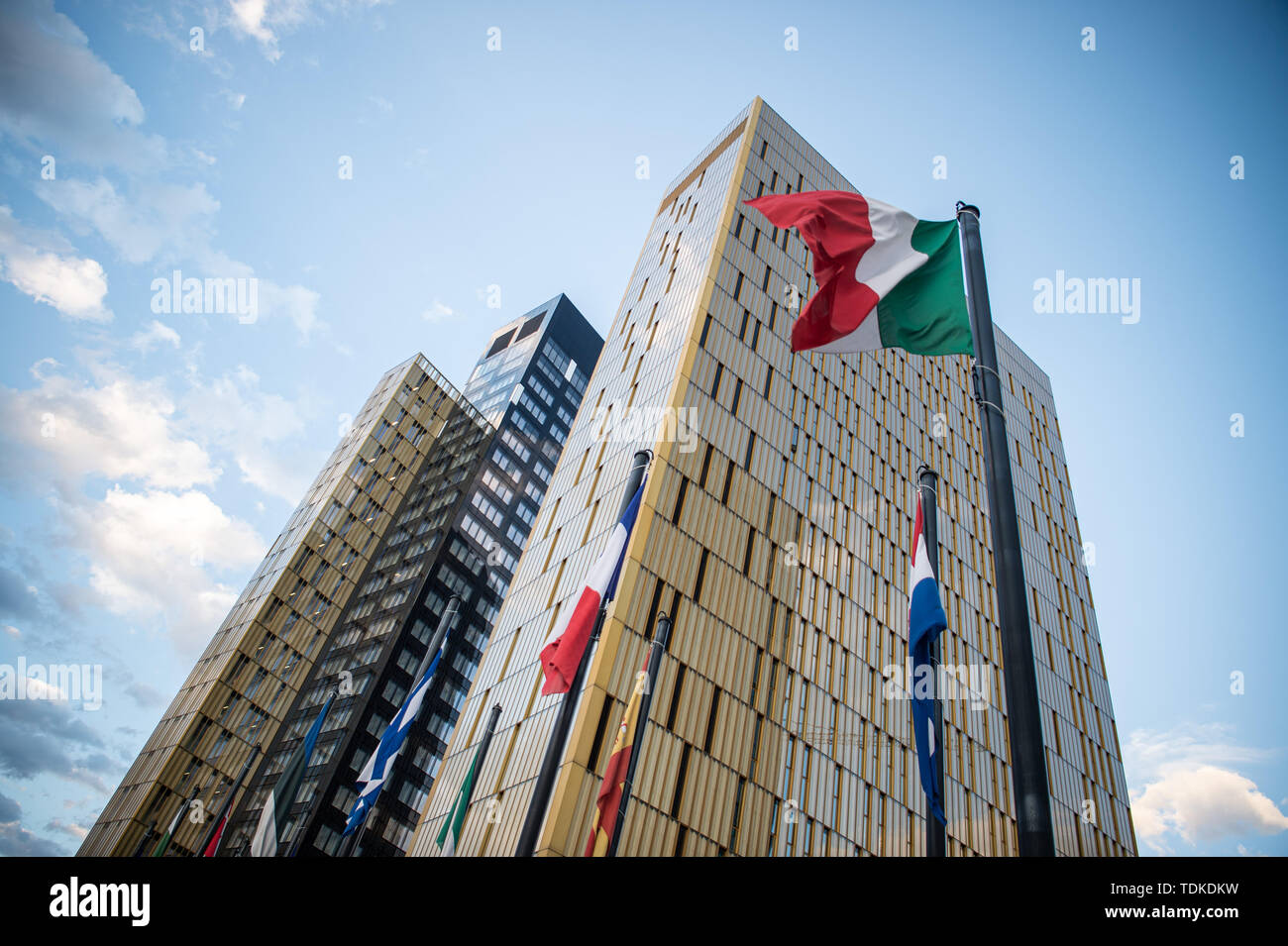Luxemburg, Luxembourg. 15th June, 2019. Flags fly in the wind in front of the office towers of the European Court of Justice in the Europaviertel on the Kirchberg. Credit: Arne Immanuel Bänsch/dpa/Alamy Live News - Stock Image