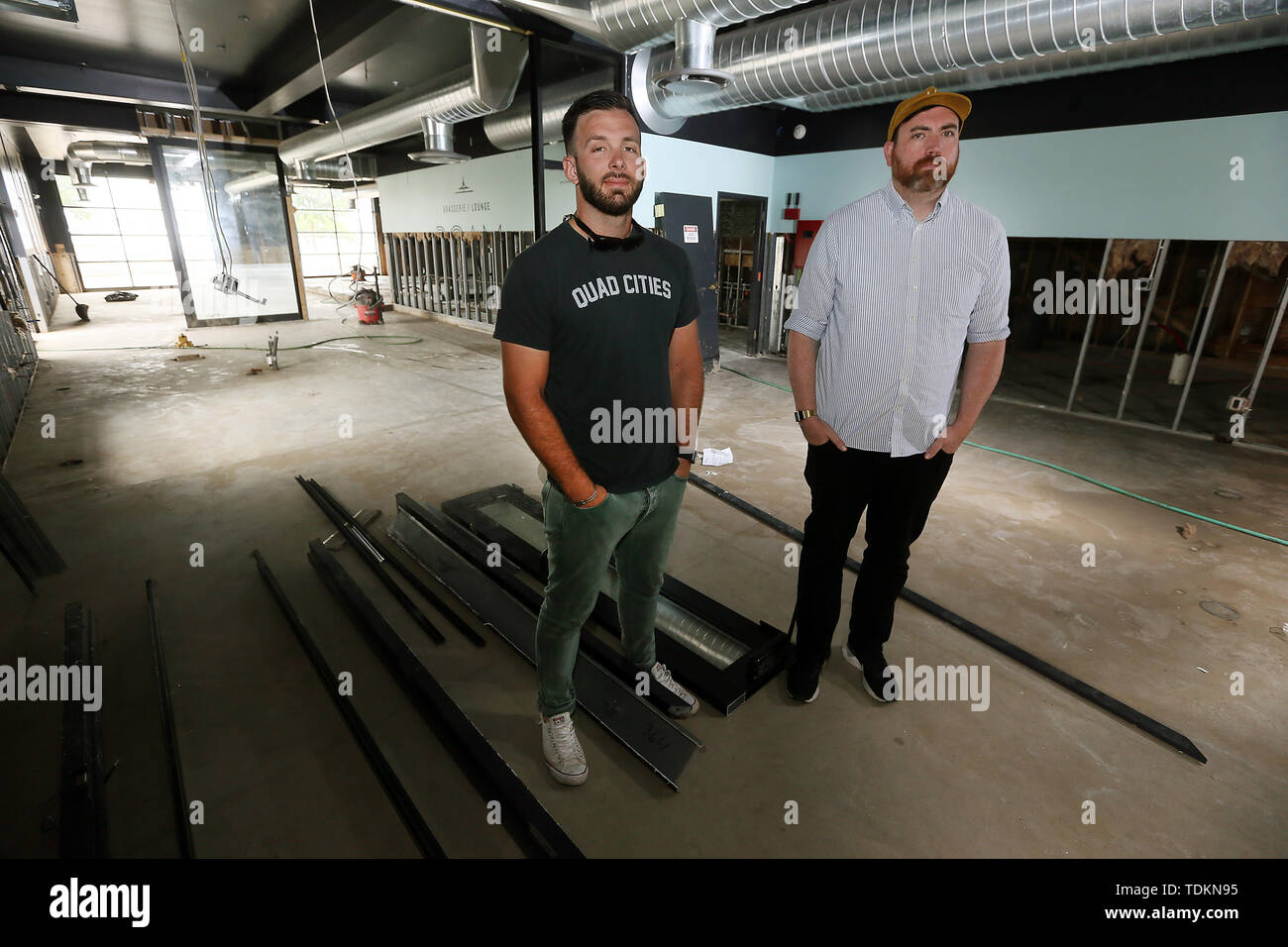 Maquoketa, Iowa, USA. 17th June, 2019. Dylan Stiel, left co-owner of Roam Restaurant in downtown Davenport, and Dan Bush, who has several downtown businesses stand in the gutted remains of the business Monday, June 17, 2019. Credit: Kevin E. Schmidt/Quad-City Times/ZUMA Wire/Alamy Live News - Stock Image