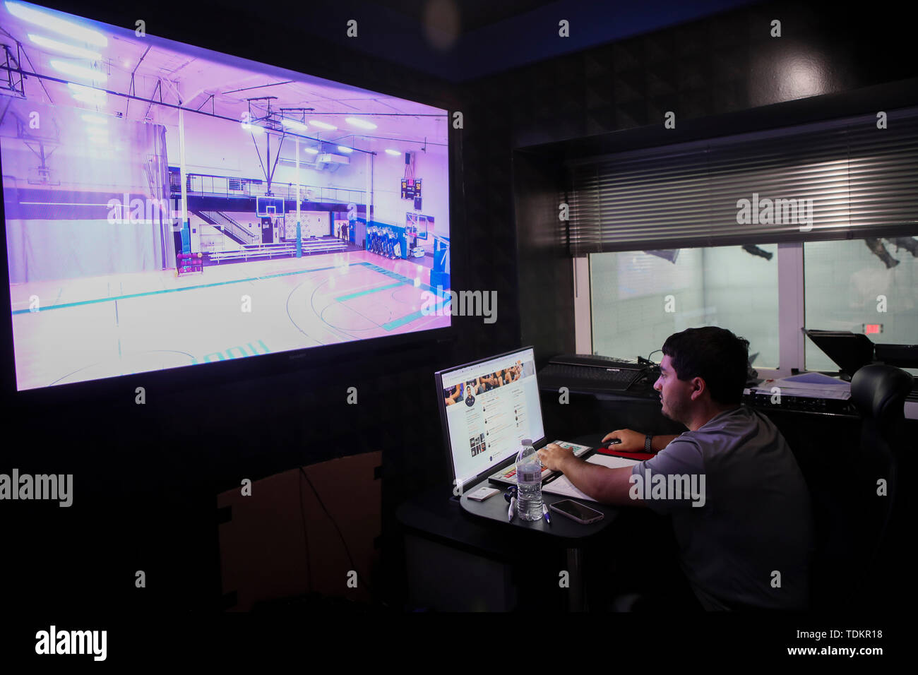 (190617) -- DAYTONA BEACH (U.S.), June 17, 2019 (Xinhua) -- A staff member monitors the live broadcast of a training court at DME Sports Academy (DMESA), in Daytona Beach of Florida, the United States, June 6, 2019. Sports skill training and culture exchange opportunities offered by DME Sports Academy for talented students and young individuals from around the world have advanced people-to-people connection between China and the United States. Established three years ago, DMESA offers top-level athletic development training and life skills mentoring to both U.S. domestic and overseas young tal - Stock Image