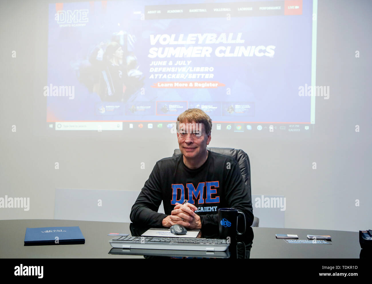 (190617) -- DAYTONA BEACH (U.S.), June 17, 2019 (Xinhua) -- Mike Panaggio, co-founder and owner of DME Sports Academy (DMESA), talks about his company in his office in Daytona Beach of Florida, the United States, June 6, 2019. Sports skill training and culture exchange opportunities offered by DME Sports Academy for talented students and young individuals from around the world have advanced people-to-people connection between China and the United States. Established three years ago, DMESA offers top-level athletic development training and life skills mentoring to both U.S. domestic and oversea - Stock Image
