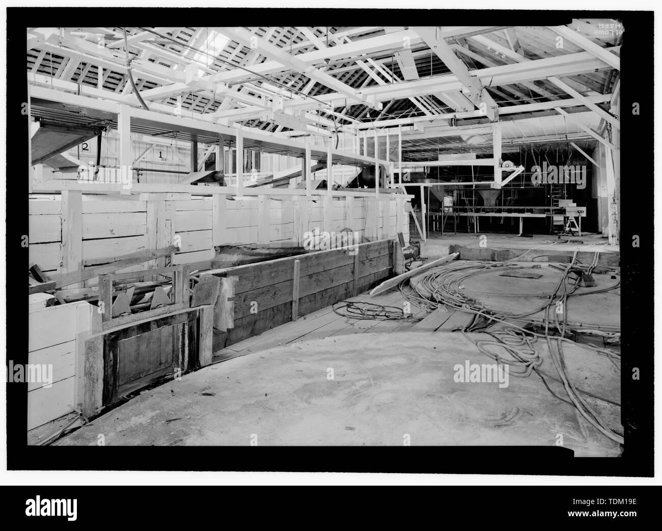 Outlet from holding tanks to storage brine tanks, iron chink in background - Kake Salmon Cannery, 540 Keku Road, Kake, Wrangell-Petersburg Census Area, AK - Stock Image