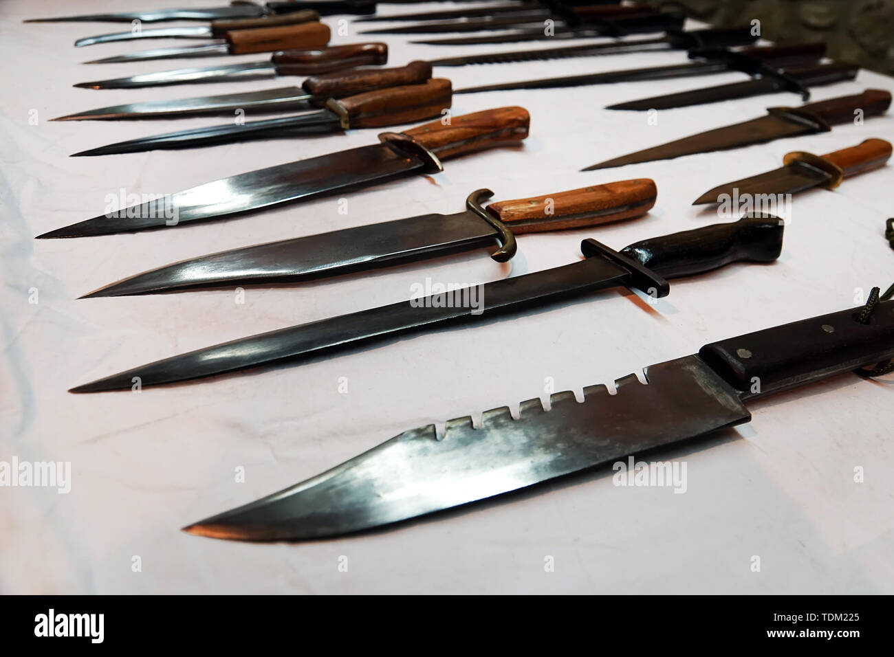 The exhibition sale of various knives of manual and industrial production . reconstruction of medieval blades - Stock Image