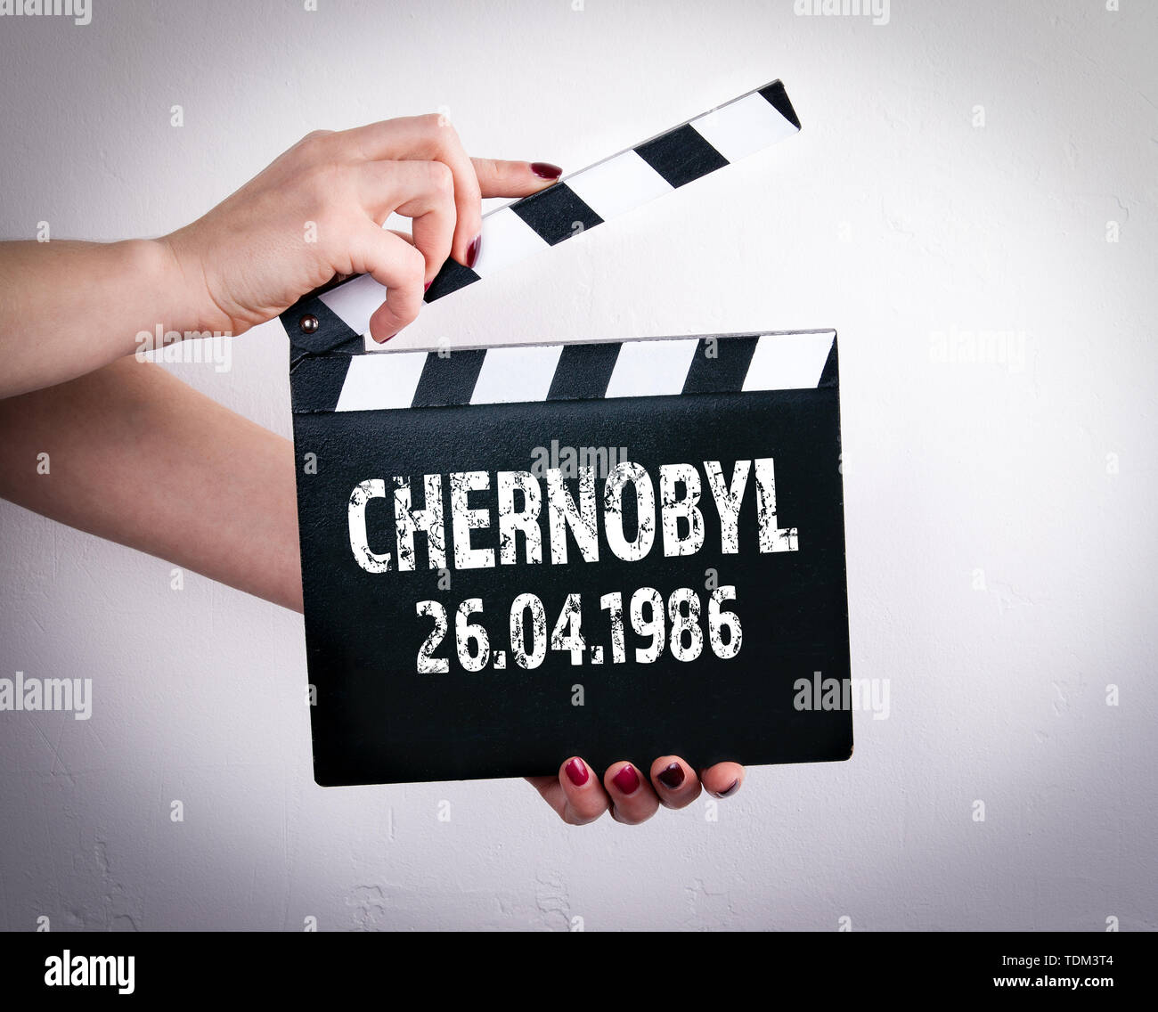 Chernobyl 26.04.1986. Female hands and movie clapper - Stock Image