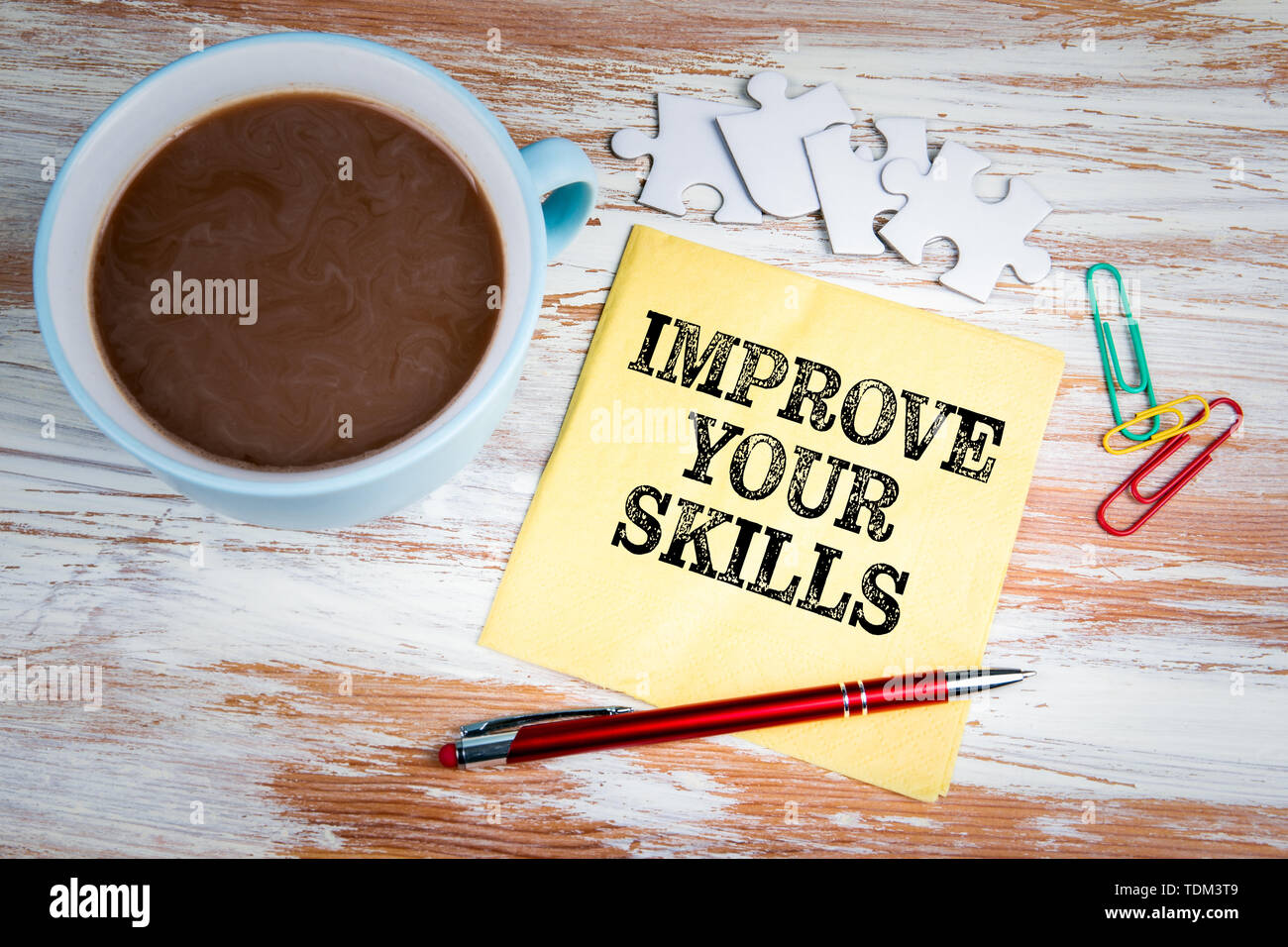 IMPROVE YOUR SKILLS concept. Text on a napkin - Stock Image