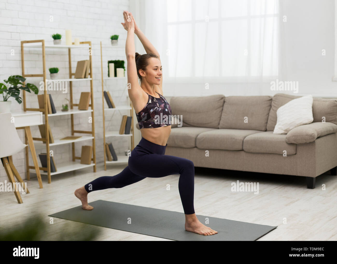 Sporty Woman Practicing Yoga, Doing Stretching Exercise - Stock Image