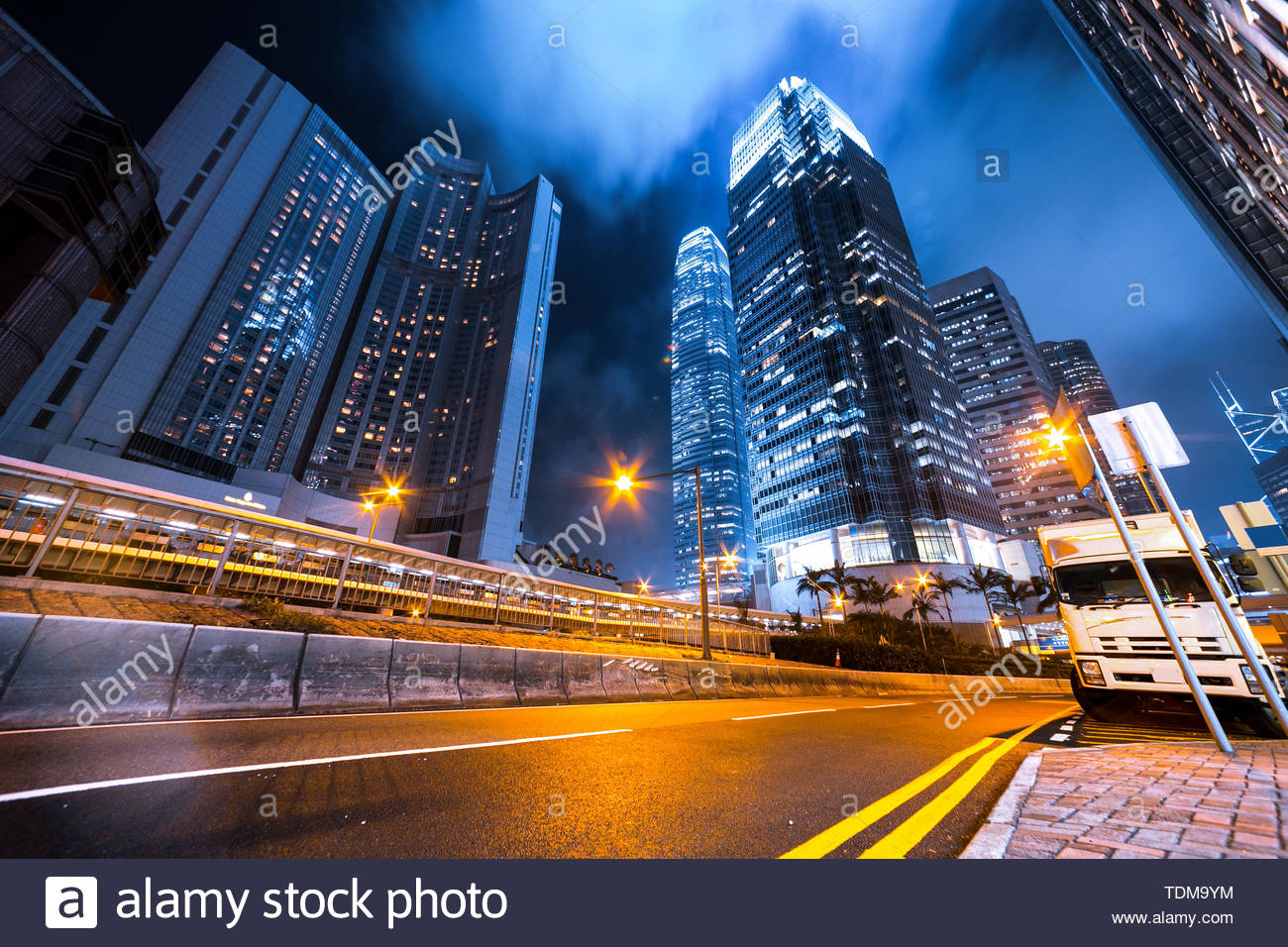 Busy traffic light trails and office buildings. Stock Photo