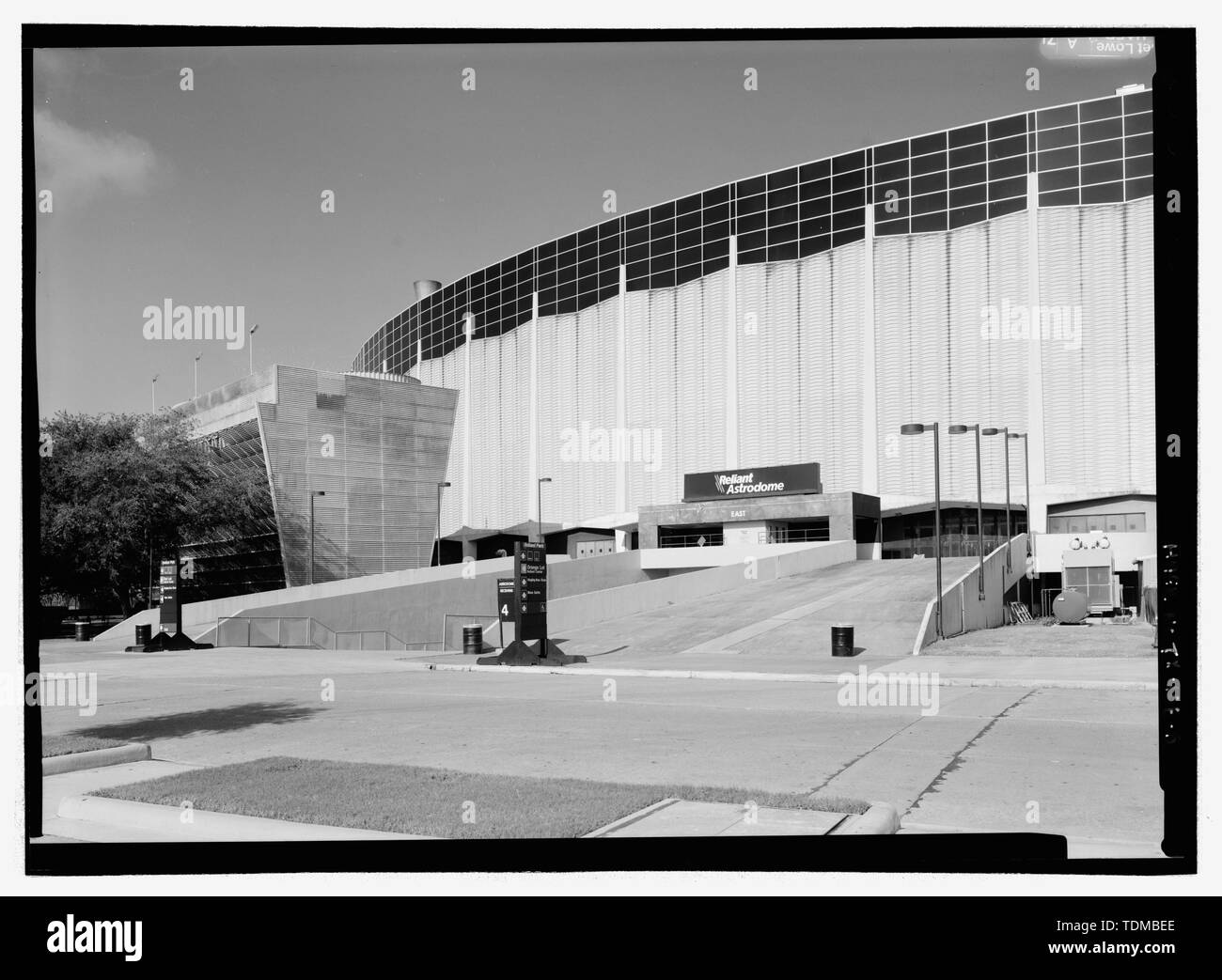 PERSPECTIVE OF EAST ELEVATION AND LARGE CHILLER, LOOKING SOUTHWEST. - Houston Astrodome, 8400 Kirby Drive, Houston, Harris County, TX; Lloyd and Morgan; Wilson, Morris, Crain and Anderson; H A Lott, Inc; Eyster, Herbert H; Sam P Wallace Company; Fish Electric; The Prescon Corporation; Walter P Moore and Associates, Inc; Praeger-Kavanagh-Waterbury; Turney, J G; Lockwood, Andrews and Newnam Inc; Dale S Cooper and Associates; Kiewitt, G R; Bass, Louis O; Bolt, Beranek and Newman; American Bridge Division; US Steel Corporation; The Rackle Company; American Seating Company; Hofheinz, Roy M; Smith,  - Stock Image