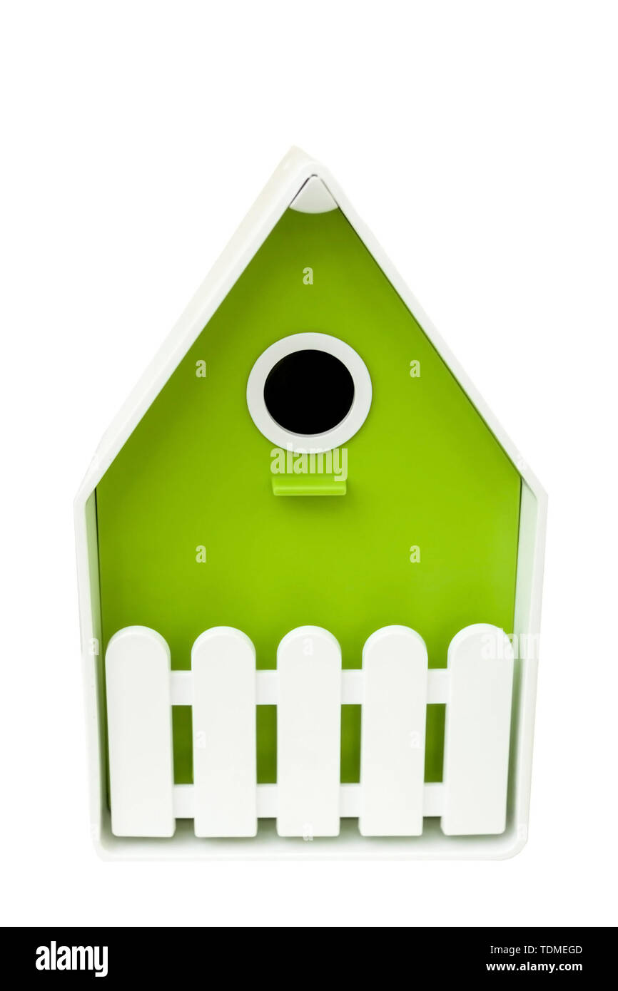 Closed artificial nesting for small birds, mostly nesting in hollows. House for birds of green color on a white background. Birdhouse for birds Stock Photo