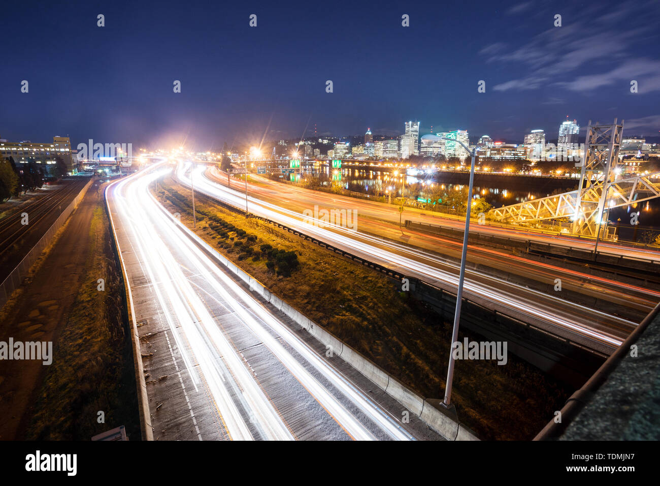 busy traffic on road at night in portland - Stock Image