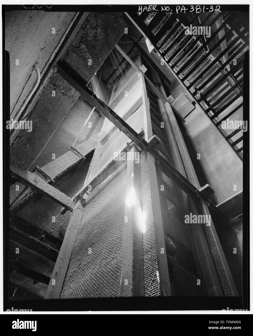 Passageway indicating man lift eliminated after OSHA safety regulations, 1913 elevator, looking west - Stewart Company Grain Elevator, 16 West Carson Street, Pittsburgh, Allegheny County, PA; D. G. Stewart Grain Company; Jesse C. Stewart Company; Union Storage Company; Groomes Construction Company; Pittsburgh-Des Moines Steel Company; R. Munroe and Sons; Webster Manufacturing, Incorporated; Stephens-Adamson Manufacturing Company; Trimble Construction Company; Richardson Scale Company; Standard Metal Products; Pittsburgh, Cincinnati and St. Louis Railway; Christine Davis Consultants, Incorporat - Stock Image