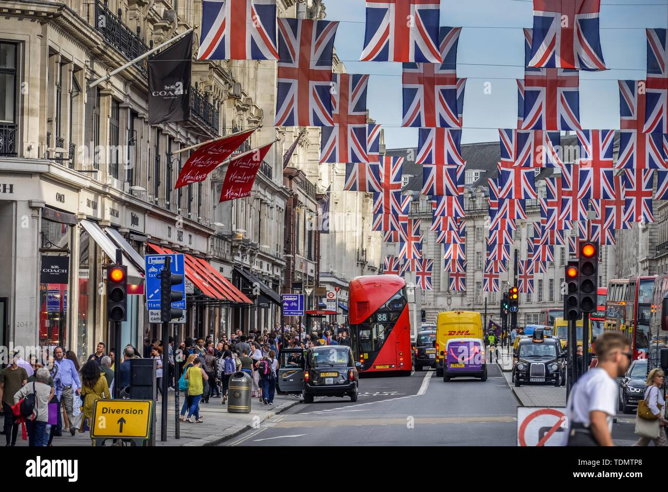 Busy street with many British flags, street scene, Regent St, London, England, United Kingdom - Stock Image