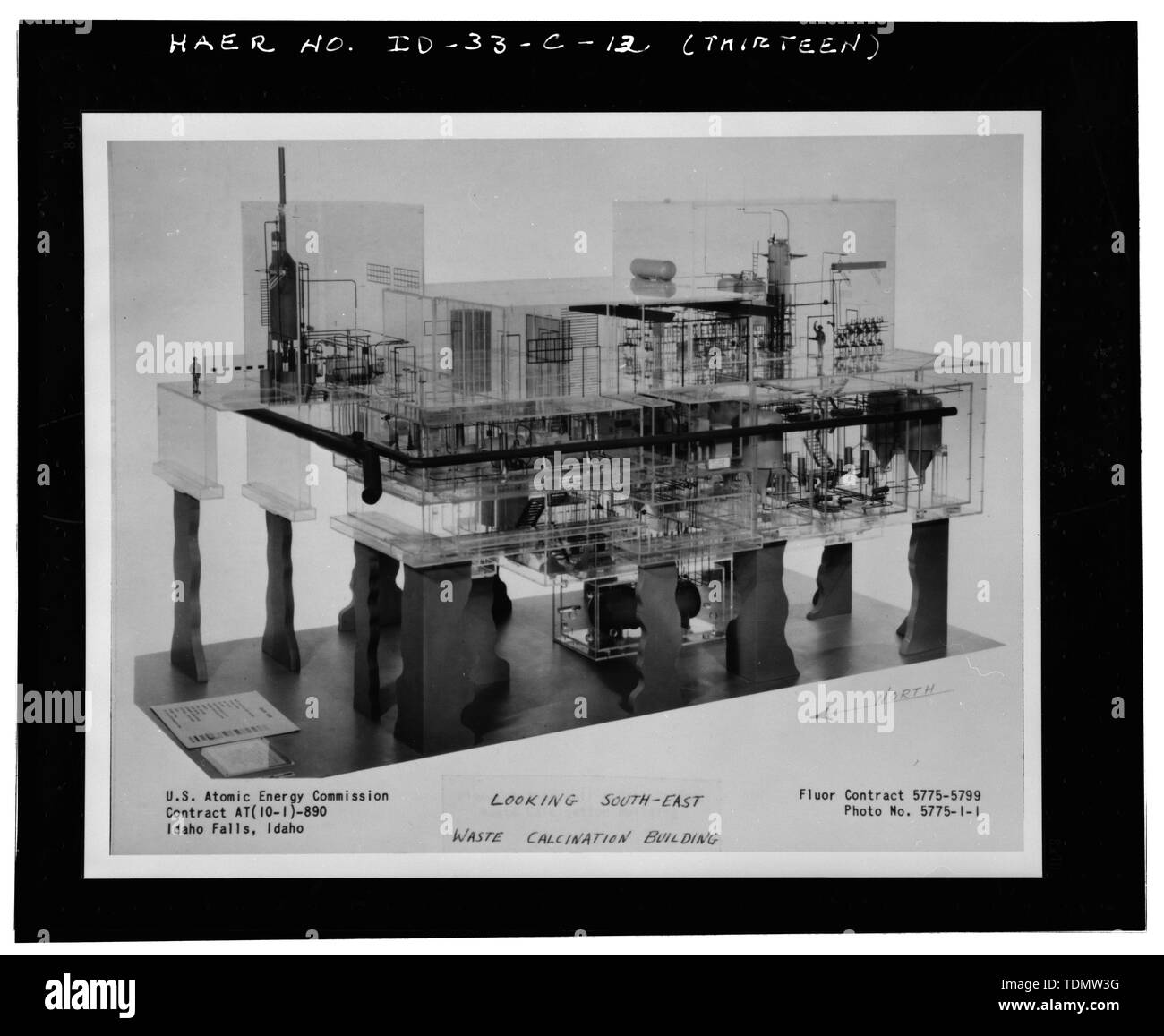 PHOTOGRAPH OF A PHOTOGRAPH OF A SCALE MODEL OF THE WASTE CALCINER FACILITY, SHOWING VIEW FACING THE SOUTHEAST. INEEL PHOTO NUMBER 95-903-1-1. - Idaho National Engineering Laboratory, Old Waste Calcining Facility, Scoville, Butte County, ID - Stock Image