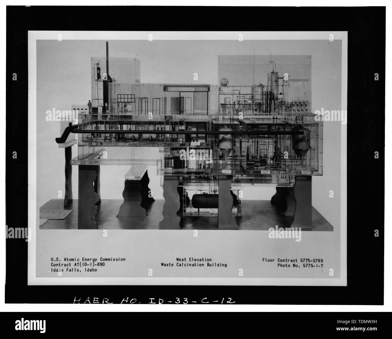 PHOTOGRAPH OF A PHOTOGRAPH OF A SCALE MODEL OF THE WASTE CALCINER FACILITY, SHOWING WEST ELEVATION. (THE ORIGINAL MODEL HAS BEEN LOST.) INEEL PHOTO NUMBER 95-903-1-3. - Idaho National Engineering Laboratory, Old Waste Calcining Facility, Scoville, Butte County, ID - Stock Image