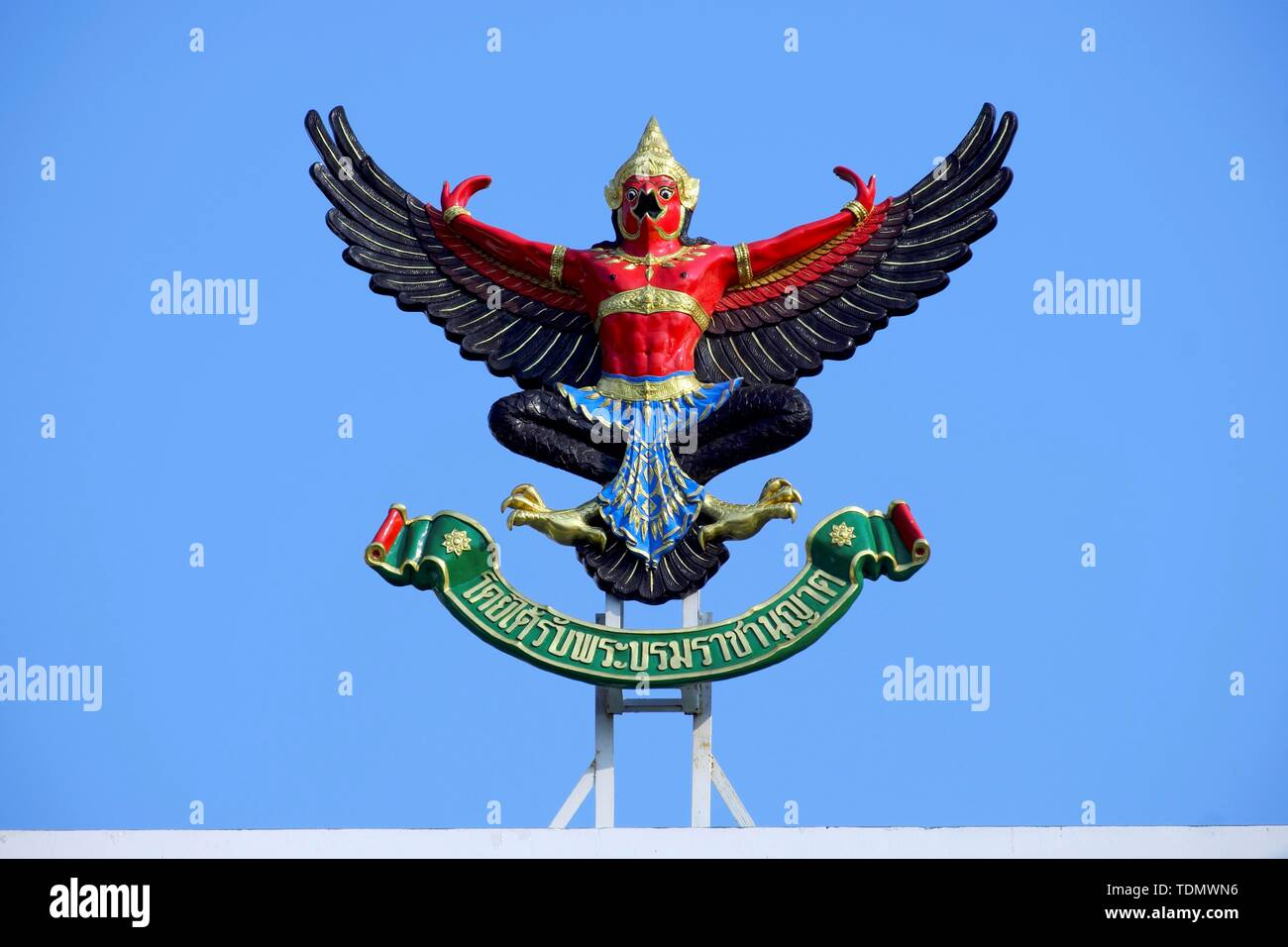 Garuda, Indian mythology, mixed creature of eagle figure and human being, national emblem, national emblem, insignia, in front of blue sky, Thailand - Stock Image