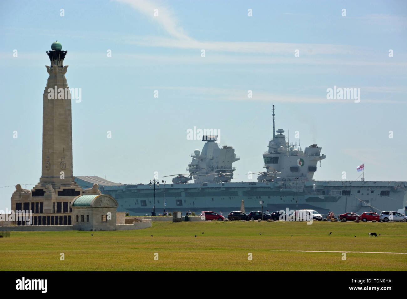 Royal Navy aircraft carrier HMS Queen Elizabeth sails past the Portsmouth Naval Memorial on Southsea Common, after sailing out of Portsmouth Harbour for sea trials. Stock Photo
