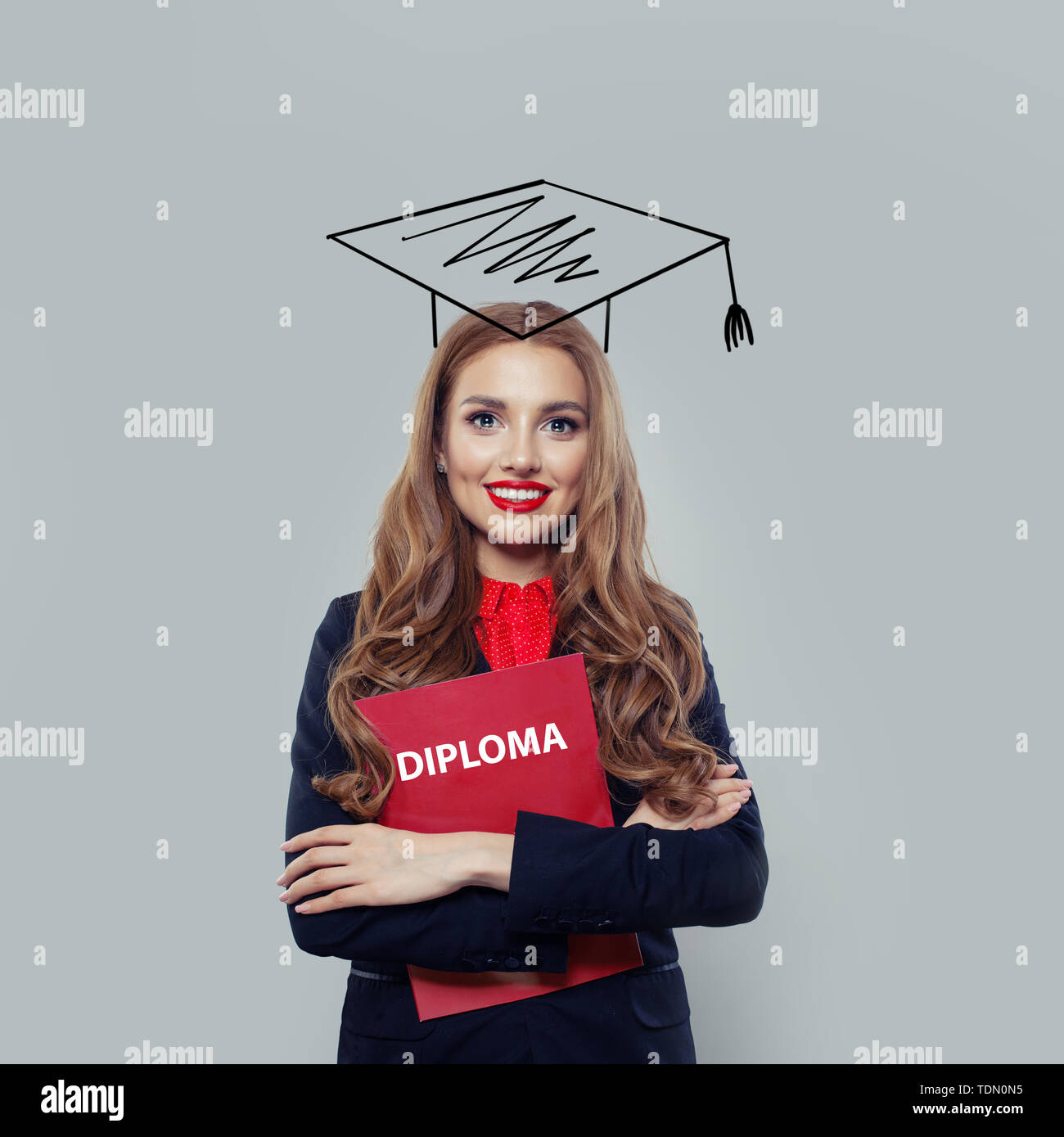 Happy young woman student with diploma on white background - Stock Image