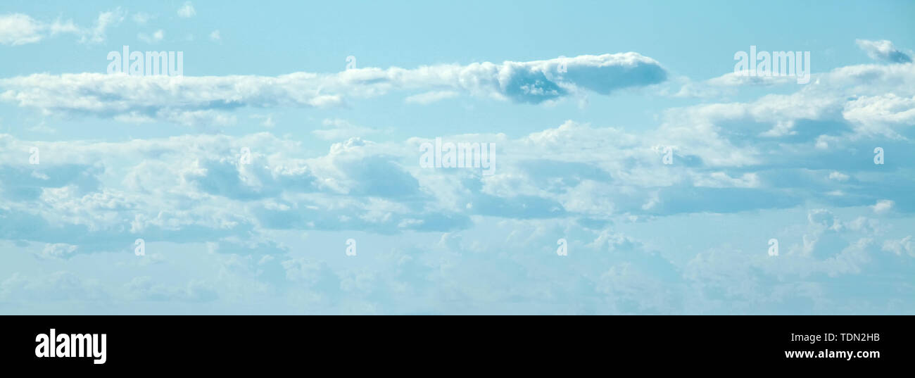 Blue sky clouds background. Beautiful landscape with clouds on sky - Stock Image