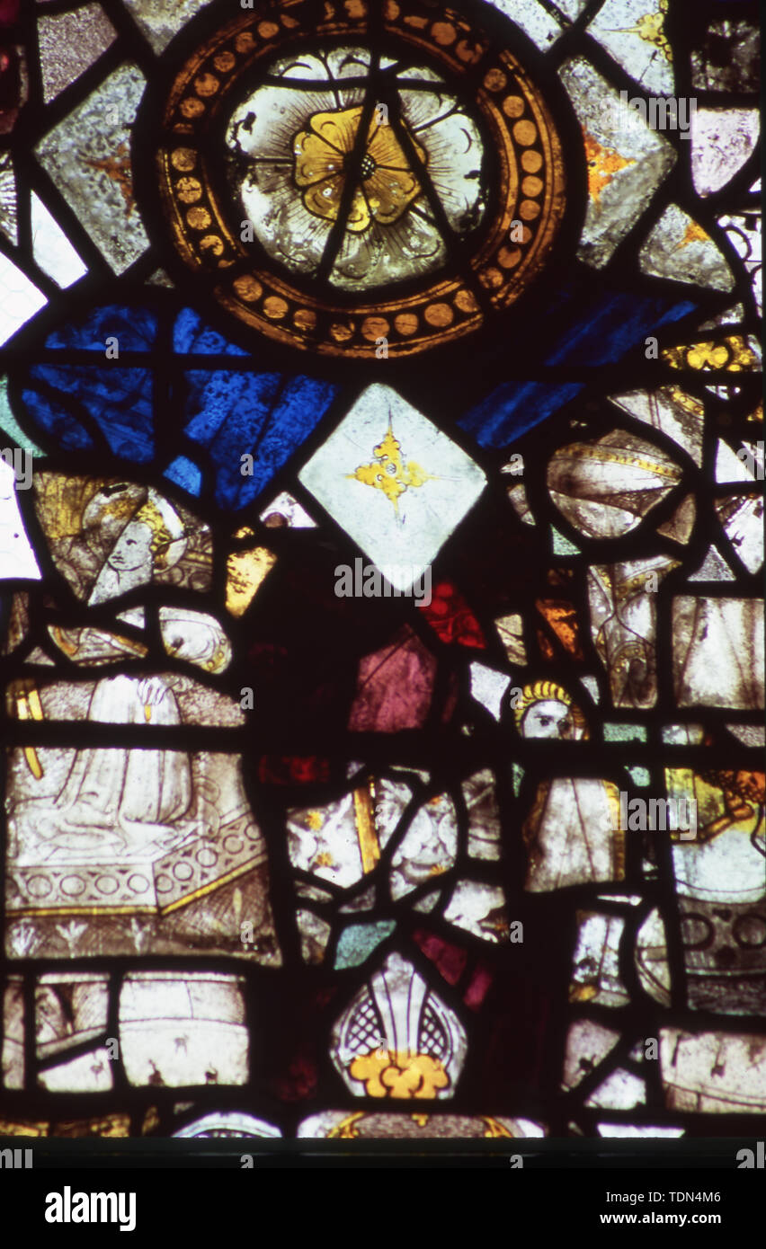 Stained glass window, 15th century glass fragments, St Mary's, Combs, Suffolk, UK. - Stock Image