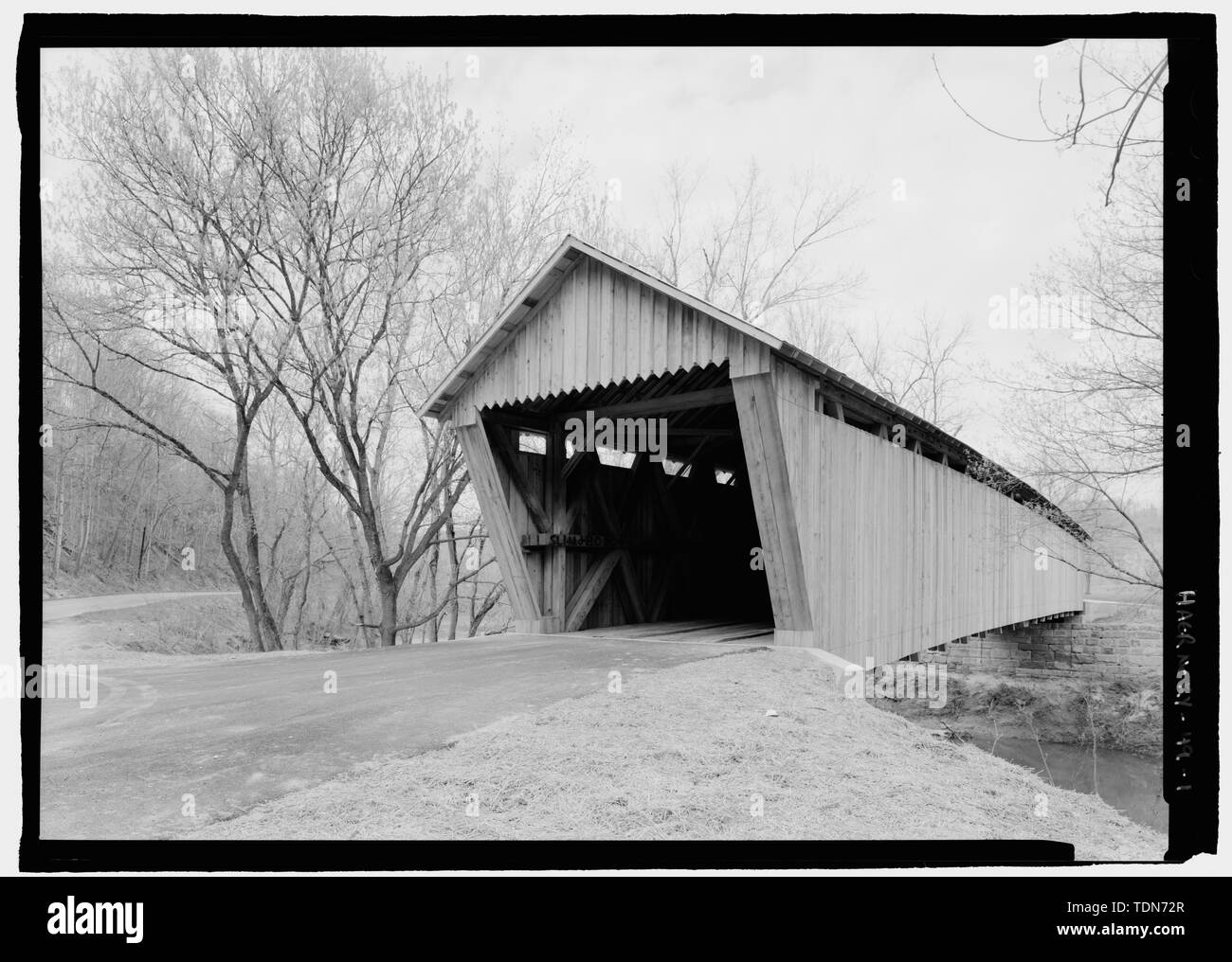 Perspective, due north. - Bennett's Mill Bridge, Spanning Tygart's Creek, East Tygart's Creek Road (CR 1215), Lynn, Greenup County, KY; Bennett, B F; Reid, A L; Wheeler, Isaac Hastings; Wheeler, William; McGee, E A; Darlington, Joseph; Darlington, Gabriel; Bennett, William  P; Bennett, Benjamin  F; Federal Highway Association; Bower Bridge Company; Bower, Louis; Intech Contracting; Marston, Christopher, project manager; Christianson, Justine, transmitter; Federal Highway Administration, sponsor - Stock Image