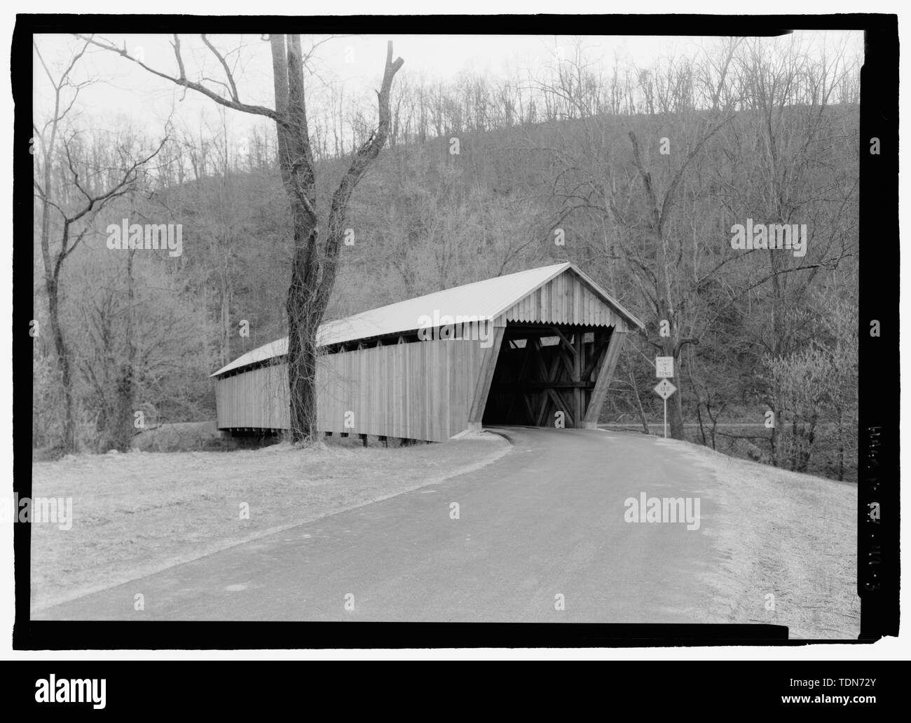 Perspective, from north. - Bennett's Mill Bridge, Spanning Tygart's Creek, East Tygart's Creek Road (CR 1215), Lynn, Greenup County, KY; Bennett, B F; Reid, A L; Wheeler, Isaac Hastings; Wheeler, William; McGee, E A; Darlington, Joseph; Darlington, Gabriel; Bennett, William  P; Bennett, Benjamin  F; Federal Highway Association; Bower Bridge Company; Bower, Louis; Intech Contracting; Marston, Christopher, project manager; Christianson, Justine, transmitter; Federal Highway Administration, sponsor - Stock Image