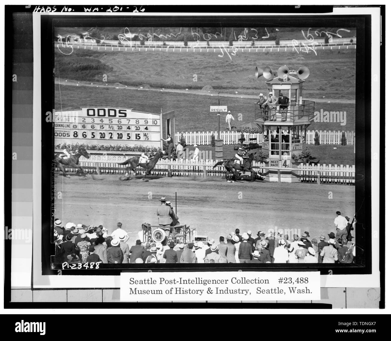 . (Original is No. PI-23488 in the Seattle Post-Intelligencer Collection at the Museum of History and Industry (MOHAI), Seattle, WA. A print from the original negative can be ordered from MOHAI.) A 1937 view of the finish line viewed from the grandstand. Note original timer's stand (infield steward stand), original 'tote' board, and picket fencing. - Longacres, 1621 Southwest Sixteenth Street, Renton, King County, WA; Gill, Barry Lee, transmitter - Stock Image