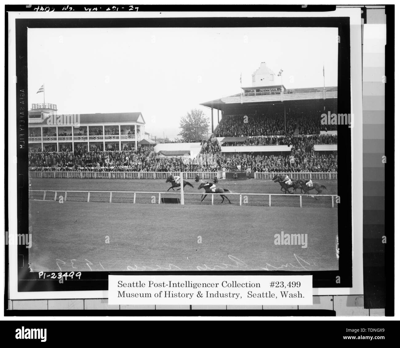 . (Original is No. PI-23499 in the Seattle Post-Intelligencer Collection at the Museum of History and Industry (MOHAI), Seattle, WA. A print from the original negative can be ordered from MOHAI.) A 1939 view of the finish line as viewed from the infield steward's booth. Original Clubhouse is on the left. On Grandstand (right) note the addition to broadcast room and structural connections between Clubhouse and Grandstand. A similar view taken in 1993 is shown in photo WA-201-8. - Longacres, 1621 Southwest Sixteenth Street, Renton, King County, WA; Gill, Barry Lee, transmitter - Stock Image