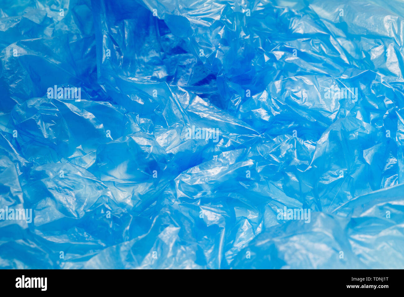 Blue Plastic Bag Texture. Abstract Wrinkled Background of Plastic Garbage - Stock Image