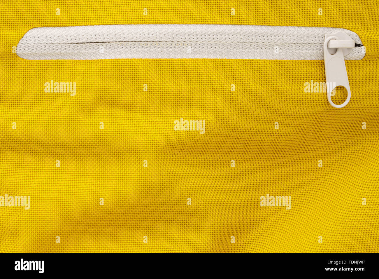 White Zipper in a Yellow Sports Backpack. Zippers Background - Stock Image