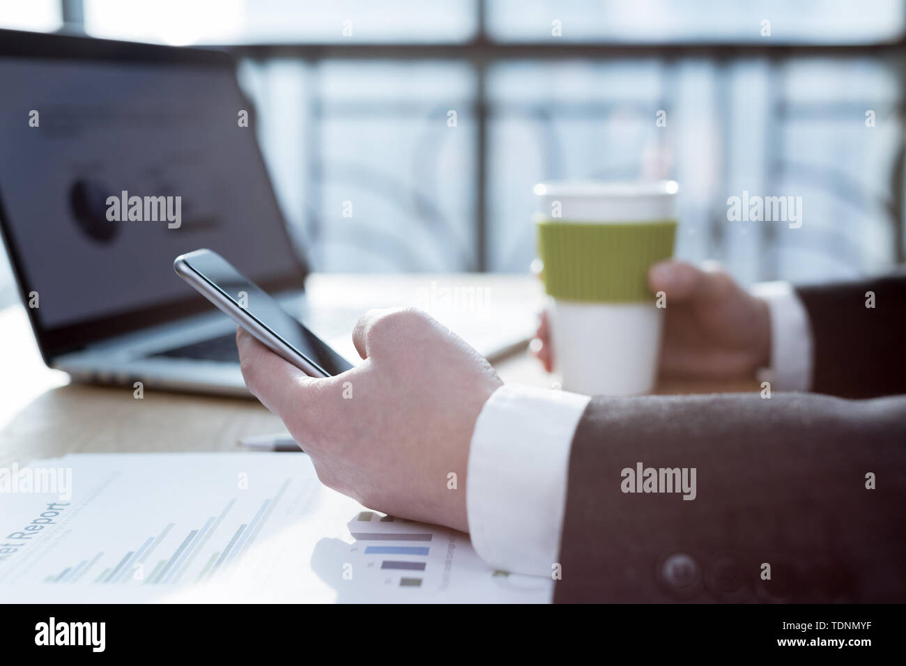 businessman looking through info on cell phone Stock Photo