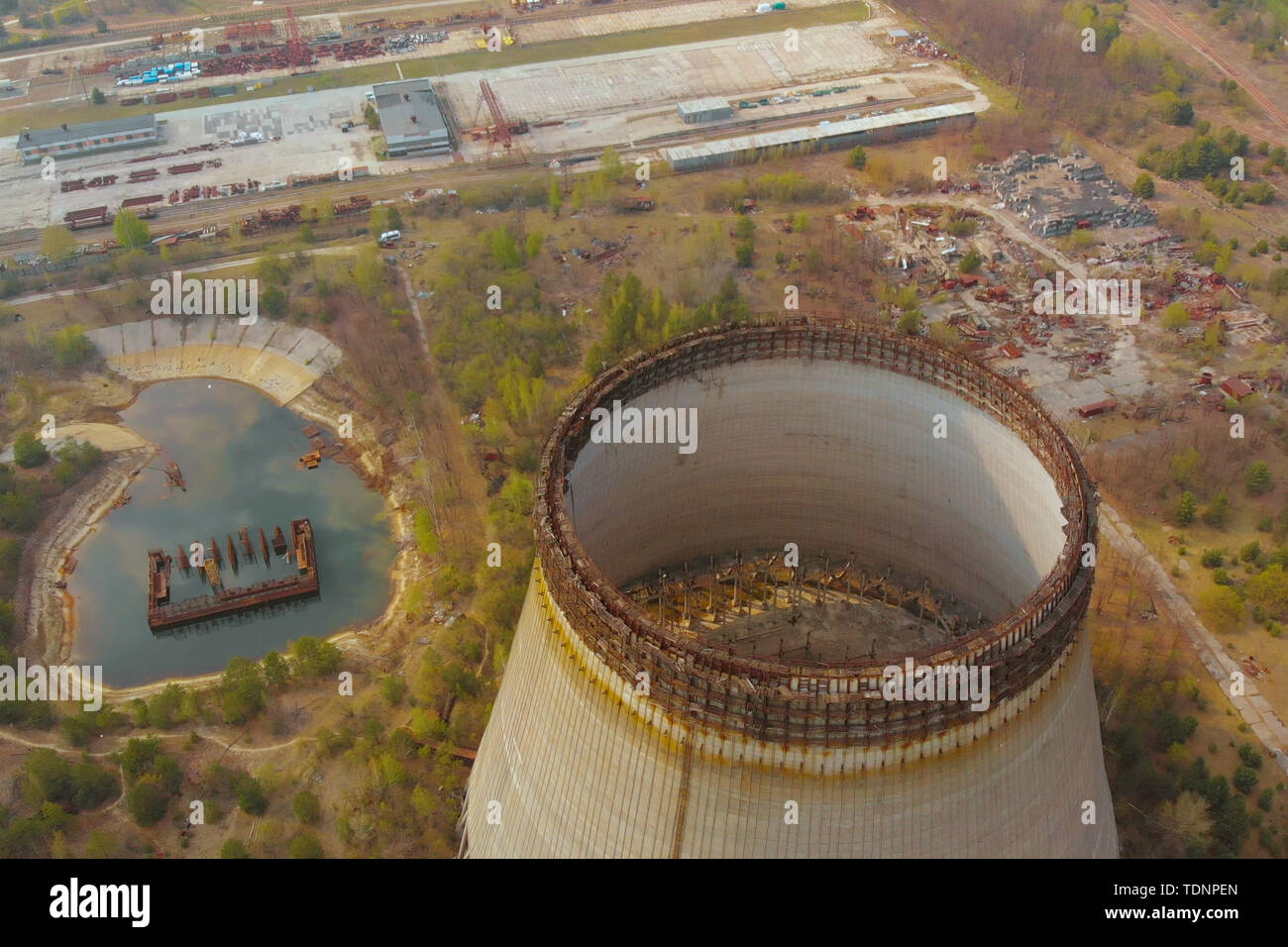 Drone flies over cooling tower near Chernobyl nuclear power plant. Chernobyl nuclear power plant. Cooling tower overlooking the nuclear power plant in - Stock Image