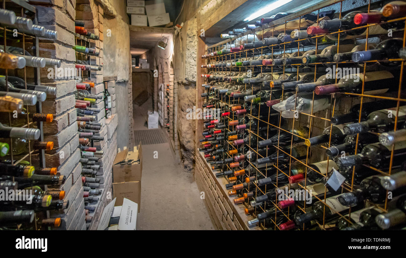 Very Old Bottles Of Wine Aging In Underground Wine Cellar In Basement Stock Photo Alamy