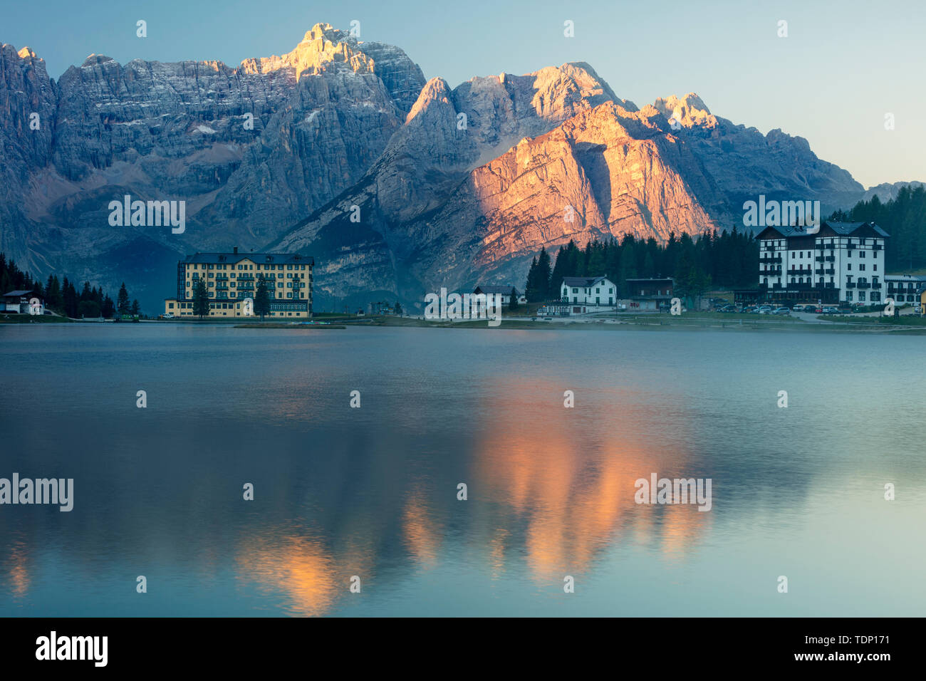The Marmarole and Sorapiss Groups of the Dolomites at first light tower over Lago Misurina, Belluno, Veneto, Italy - Stock Image