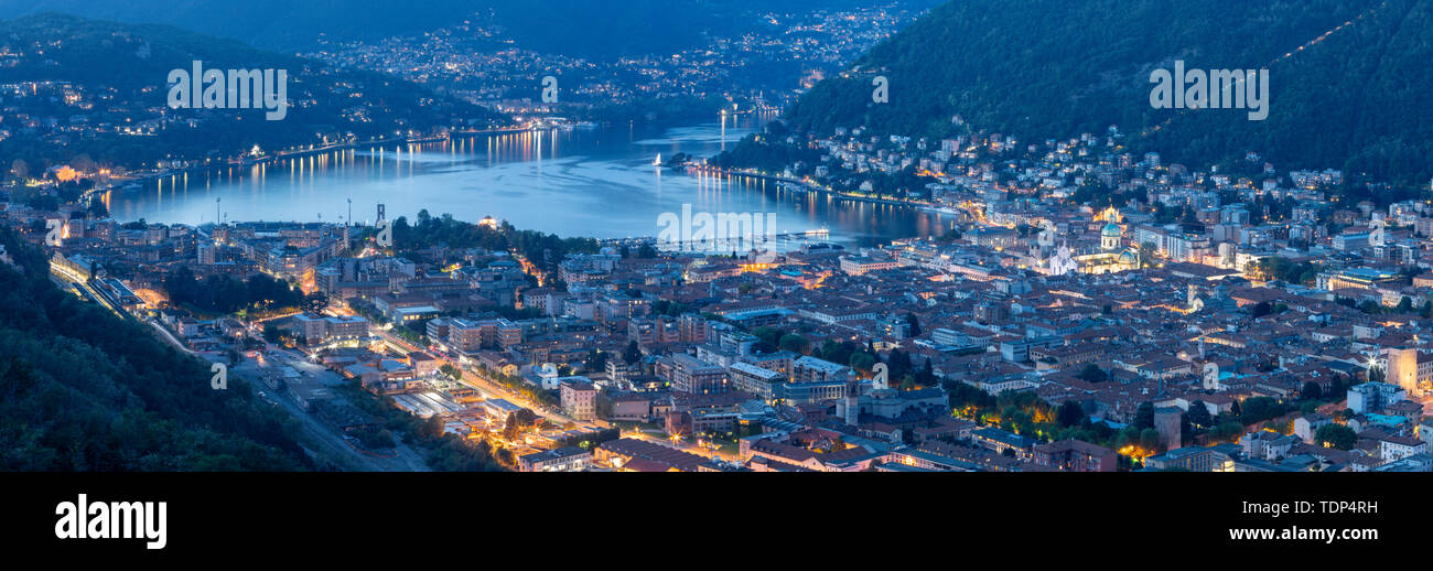 Como - The panorama of the City with the lake Como at dusk. - Stock Image