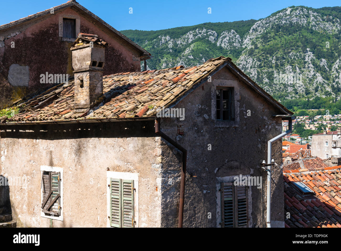 Red tiled roofs of the old town houses in Kotor, Montenegro - Stock Image