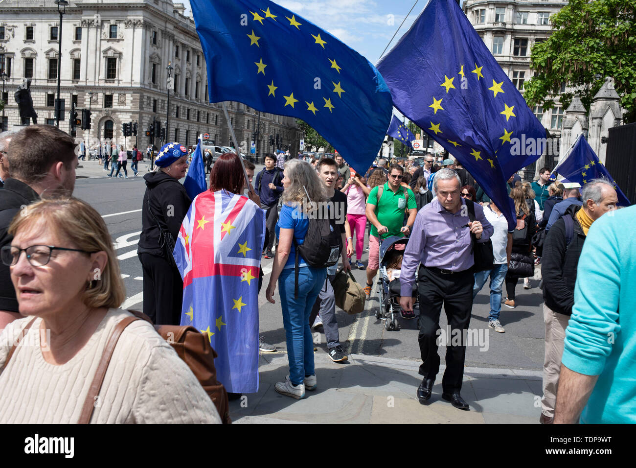 Anti Brexit protesters waving European Union flags in Westminster as inside Parliament the Tory leadership race continues on 17th June 2019 in London, England, United Kingdom. - Stock Image