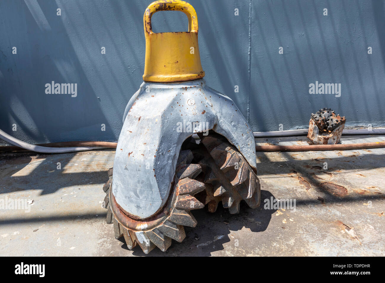 Morgan City, Louisiana - A drill bit on the deck of the 'Mr. Charlie' offshore oil drilling rig, which is now a tourist attraction and training facili - Stock Image