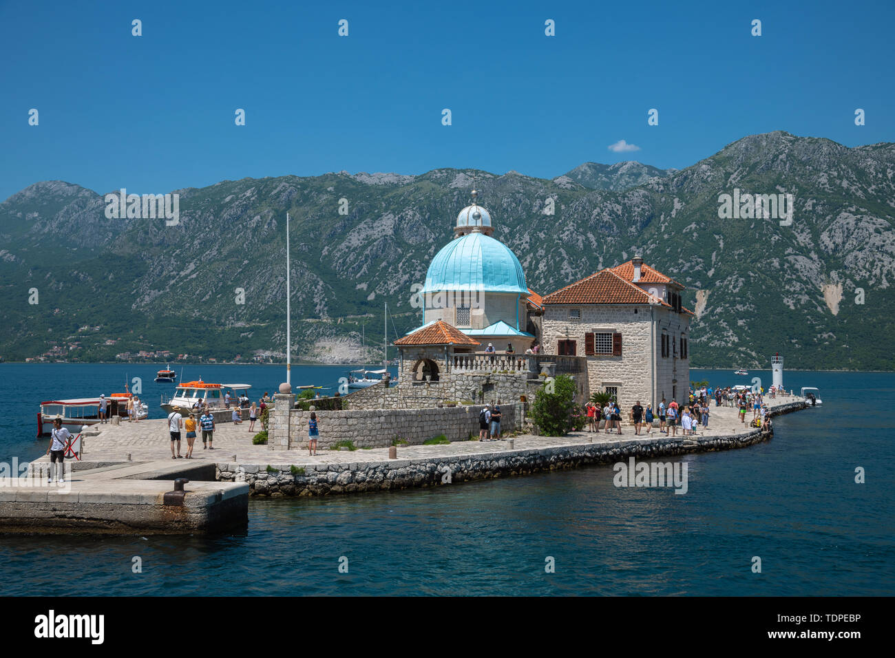 Perast, Montenegro - June 10. 2019: Church of Our Lady of Rocks on artificial island of Gospa od Skrpjela. - Stock Image